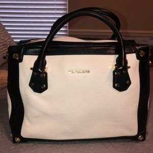 White and black MK purse